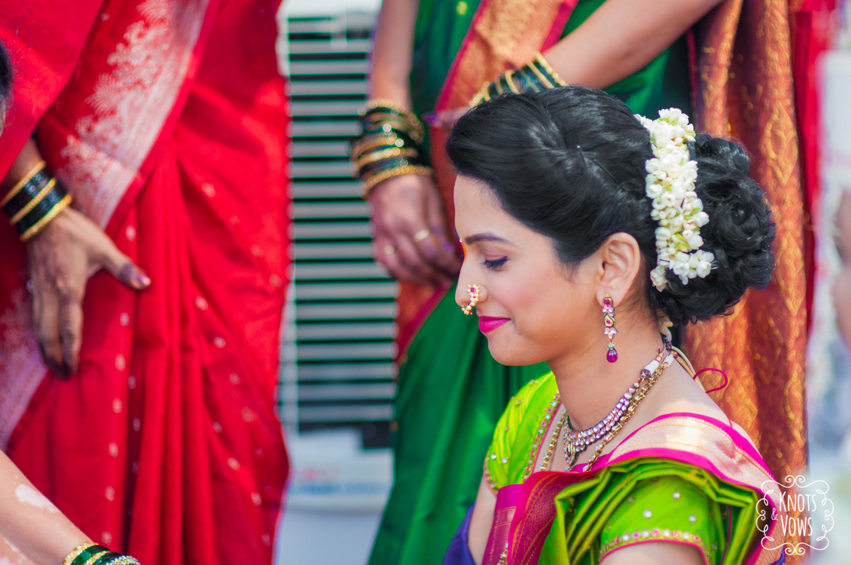 bridal hairstyles maharashtrian: bright yellow paithaini saree and